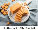 cheddar cheese on a wooden... | Shutterstock . vector #1071152423