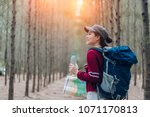 asia woman travel with backpack ... | Shutterstock . vector #1071170813