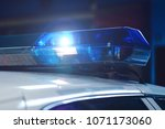 police at night in the car with ... | Shutterstock . vector #1071173060