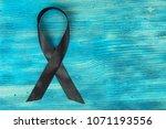 black ribbon symbol of fight... | Shutterstock . vector #1071193556