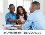 handhake after signing contract ... | Shutterstock . vector #1071204119