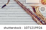 the saxophone is placed on a... | Shutterstock . vector #1071219926