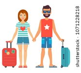 man and woman with suitcases.... | Shutterstock .eps vector #1071228218