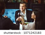 three young business partners... | Shutterstock . vector #1071242183