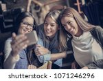 self portrait of young girls.... | Shutterstock . vector #1071246296