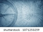 old vintage retro compass on... | Shutterstock . vector #1071253259