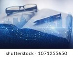 notepad  blurry glasses and pen ... | Shutterstock . vector #1071255650