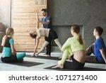 yoga teacher and beginners in...   Shutterstock . vector #1071271400