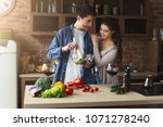 happy couple cooking and... | Shutterstock . vector #1071278240