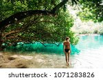a young woman in blue lagoon in ... | Shutterstock . vector #1071283826