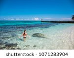 a young woman in blue lagoon in ... | Shutterstock . vector #1071283904