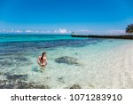 a young woman in blue lagoon in ... | Shutterstock . vector #1071283910