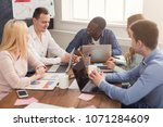 business meeting of young... | Shutterstock . vector #1071284609