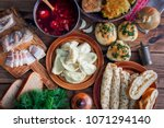 covered table with traditional... | Shutterstock . vector #1071294140