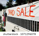 yard sale painted sign attached ... | Shutterstock . vector #1071296078
