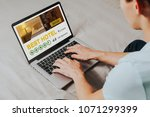 man booking the best hotel for... | Shutterstock . vector #1071299399