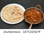 popular breakfast dish parotta... | Shutterstock . vector #1071325679