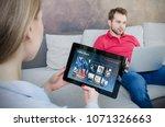 woman using digital tablet for... | Shutterstock . vector #1071326663