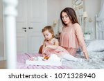 a daughter with her mother in... | Shutterstock . vector #1071328940