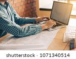 architect sitting in modern... | Shutterstock . vector #1071340514