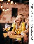 girlfriends drinking wine and... | Shutterstock . vector #1071342389