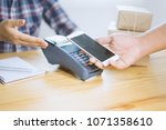 hand holding smart phone over... | Shutterstock . vector #1071358610