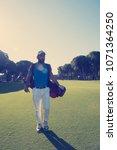 handsome middle eastern golf... | Shutterstock . vector #1071364250