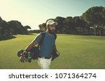 handsome middle eastern golf... | Shutterstock . vector #1071364274