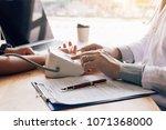 doctor pressing pressure gauge... | Shutterstock . vector #1071368000