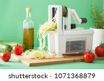 spiralizing courgette raw...   Shutterstock . vector #1071368879