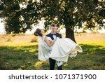 groom took the bride in his... | Shutterstock . vector #1071371900