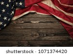 old usa flag on wooden... | Shutterstock . vector #1071374420