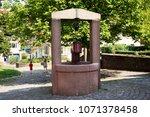 classic dug water well at... | Shutterstock . vector #1071378458