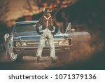 American Wild West Classic Car Ride and the Cowboy. Retro Car Theme. - stock photo