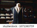 close up of a suit hanging on... | Shutterstock . vector #1071383759