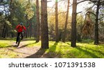 cyclist riding the mountain... | Shutterstock . vector #1071391538