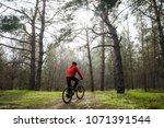 cyclist riding the mountain... | Shutterstock . vector #1071391544
