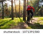 cyclist riding the mountain... | Shutterstock . vector #1071391580