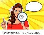 girl with megaphone pop art...   Shutterstock .eps vector #1071396803