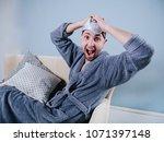 guy in bathrobe  dancing or... | Shutterstock . vector #1071397148