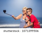 summer holiday.grandmother with ... | Shutterstock . vector #1071399506