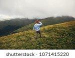 stylish traveler man in hat... | Shutterstock . vector #1071415220