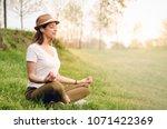 young beautiful woman... | Shutterstock . vector #1071422369