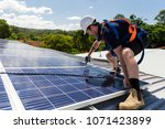 solar panel technician with... | Shutterstock . vector #1071423899