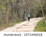 a man carry backpack is... | Shutterstock . vector #1071446018