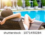 Small photo of Summer fun in holiday, Happy beautiful woman relaxing sunbathe near luxury swimming pool, summer holiday vacation concept.