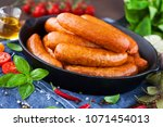 lots of bbq sausages with... | Shutterstock . vector #1071454013