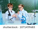 two children scientists making... | Shutterstock . vector #1071459683