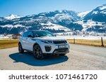 white range rover evoque.... | Shutterstock . vector #1071461720