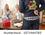 young man holding flowers... | Shutterstock . vector #1071464783